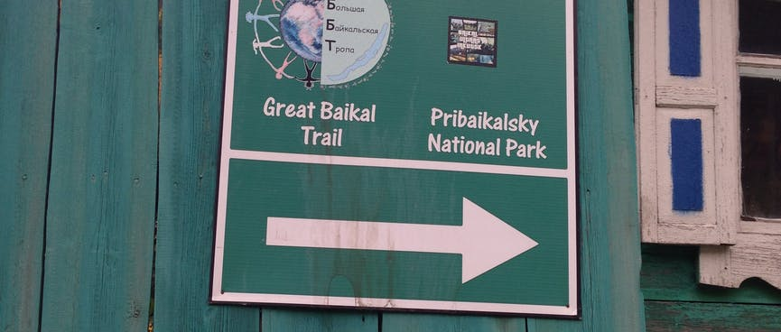 A sign points to Great Baikal Trail and Pribaikalsky National Park.