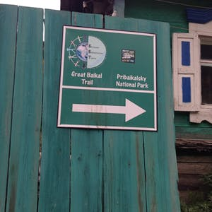 View enlargement of A sign points to Great Baikal Trail and Pribaikalsky National Park.