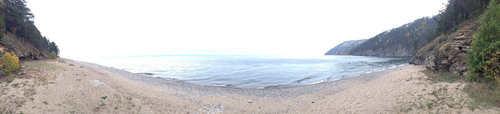 A panorama of the sandy shoreline.