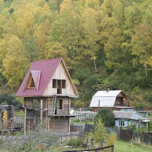 A three story wooden house reminiscent of a children's tree house.