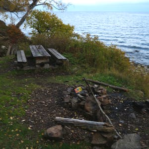 A used fire pit on the lake edge.