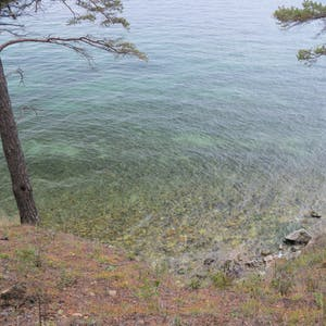 View enlargement of The lake bottom is visible through its clear waters.