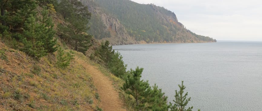 The dirt trail and winds its way into the cove ahead.