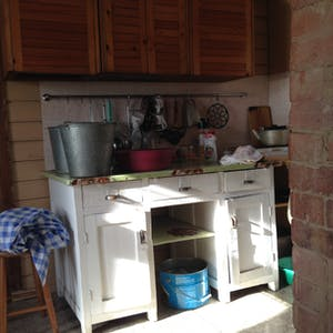 View enlargement of Small but highly functional kitchen.