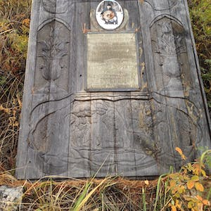 View enlargement of Carved headstone.