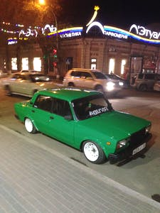 The pimped Lada, with white mags and low profile tyres.
