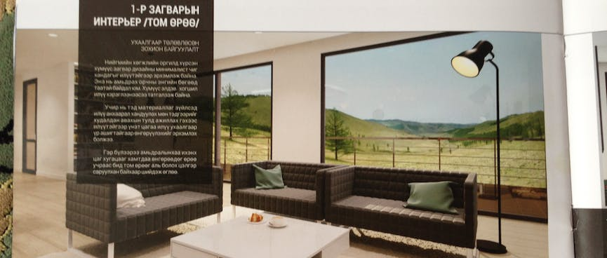 Brochure page showing a modern apartment with a view across the steppes.
