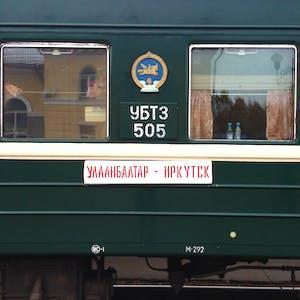 The side of a green railway carriage of the Ulaanbaatar to Irkutsk train.
