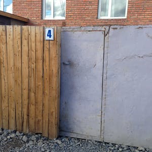 The humble entrance to the yard.