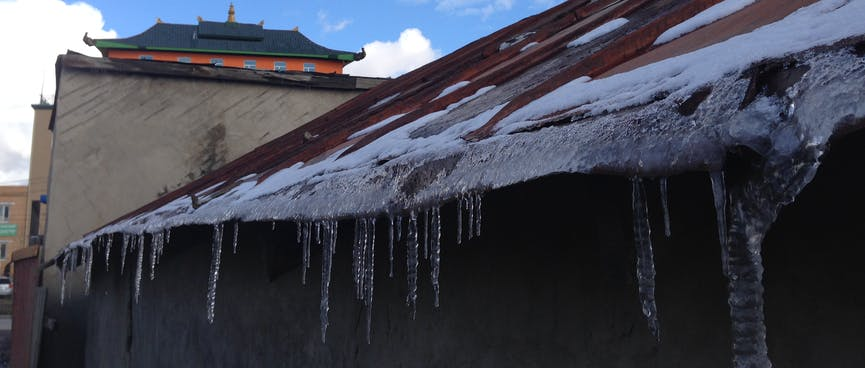 Stalactites hang from a tin roof.