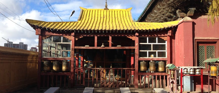 Open temple building with a yellow ridged roof.