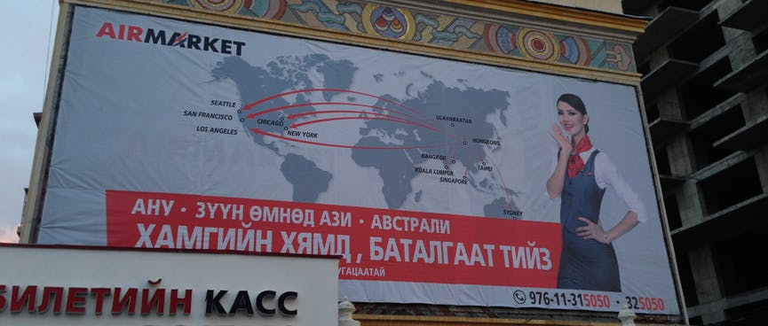 A huge billboard shows flight connections between Ulaanbaatar, America and Australasia.
