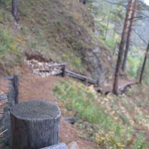 View enlargement of Logs brace short wooden staircases.