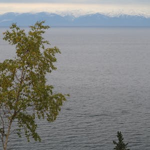 View enlargement of Mountains on the other side of the lake.