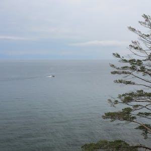 View enlargement of A small boat, maybe 100m offshore.