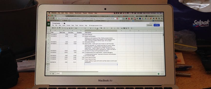 A spreadsheet of timesheet entries on the screen of my MacBook Air.