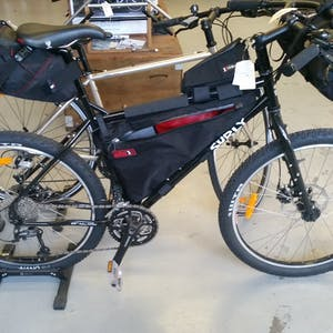 View enlargement of Surly Troll fitted with handlebar, frame and seat packs.