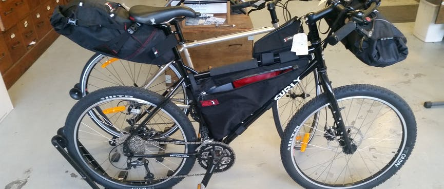 Surly Troll fitted with handlebar, frame and seat packs.