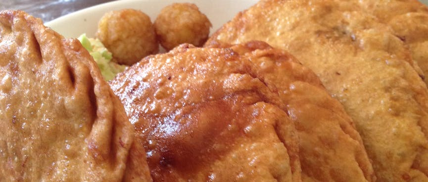 Deep fried half rounds of pastry.