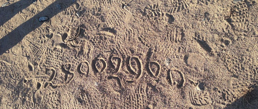 Numbers written in the sand.