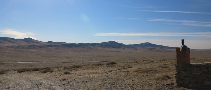 Barren steppes and distant hills.