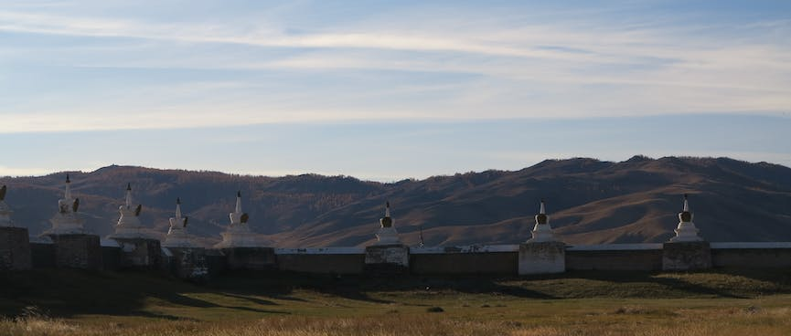 White stone monuments at equal intervals on the perimeter wall.
