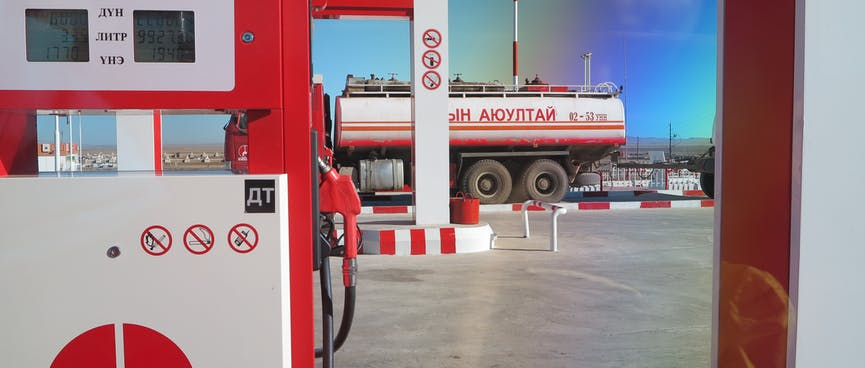 Red and white petrol pumps.