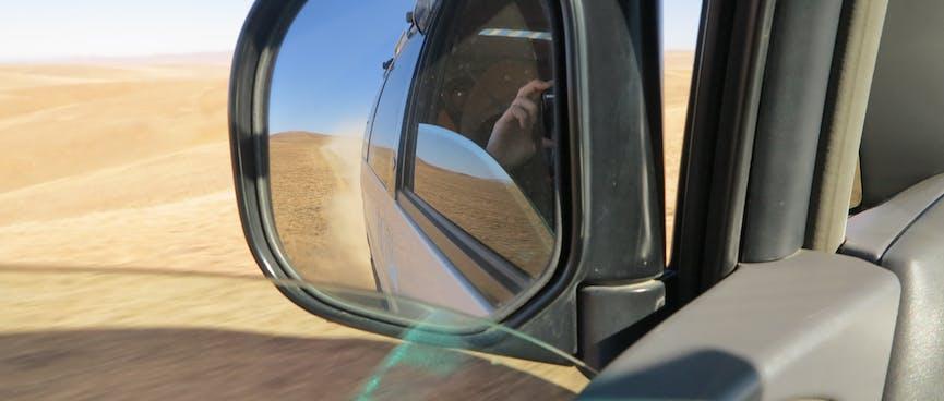 Reflections in the van's wing mirror.