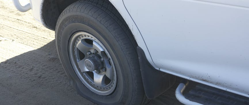The flat front left tyre of our van.