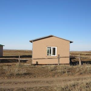 Modern huts, with windows.
