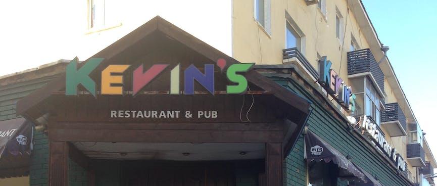 Futuristic multi-coloured lettering above a restaurant's entranceway.