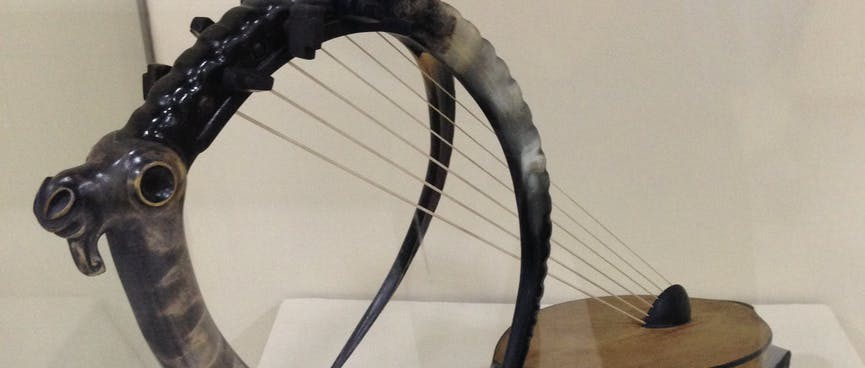 An ancient bow harp resembles an antelope with curved tusks.